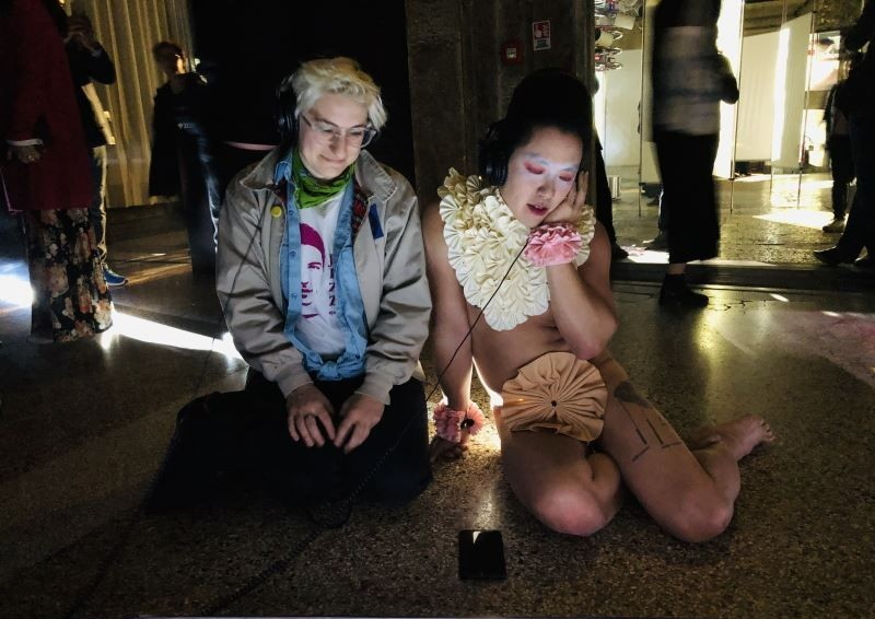 "A performer (right) watches a film with an exhibitiongoer during the opening of the Taiwan pavilion ""3x3x6"" at the 58th International Art Exhibition o"