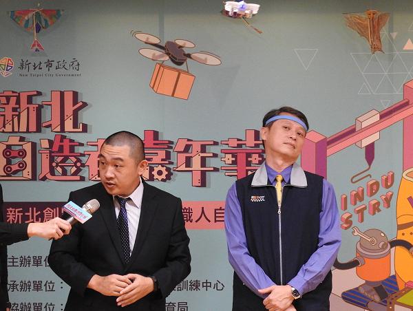 New Taipei Labor Bureau Chief, Chen Rui-Chia (R) controls brain operated drone