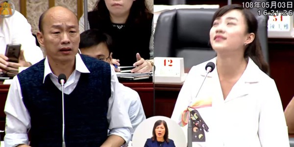 Screenshot of video from city council meeting showing Huang roll her eyes at Han.