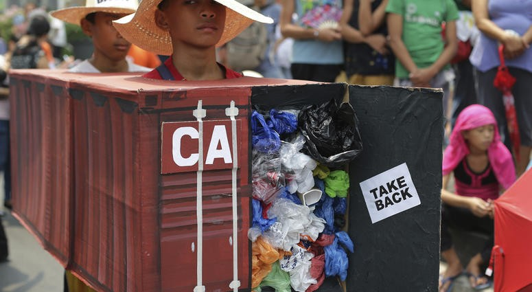 Protester calling for Canada to retrieve their trash
