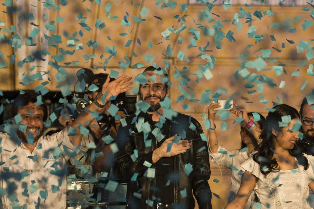 Felix Ulloa (left) celebrating the victory of President Nayib Bukele (center) in February.