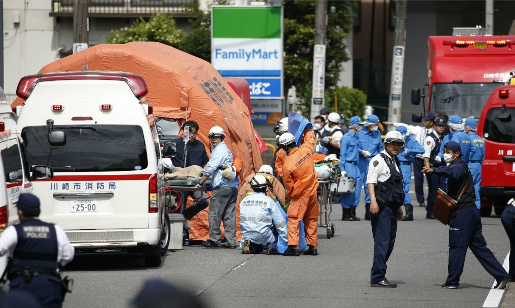 Emergency rescue workers at bus stop in Kawasaki, near Tokyo Tuesday, May 28