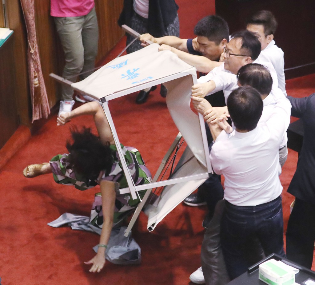 Legislators scuffle over a confirmation vote for the new Central Election Commission chairman Tuesday May 28.