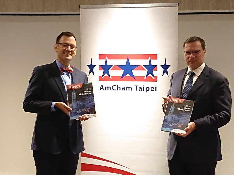 AmCham Taipei President William Foreman (left) and Chairman Leo Seewald present the latest edition of the Taiwan White Paper.