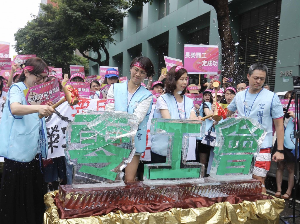 EVA Air flight attendants destroy ice blocks symbolizing the company's 'zero union' attitude.