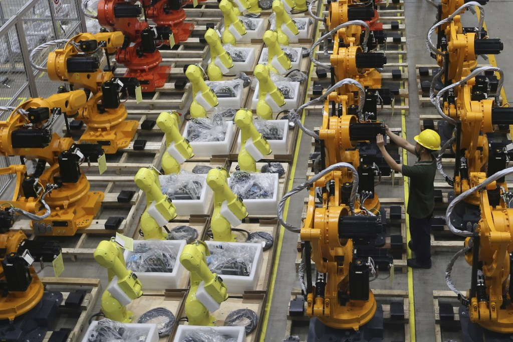 Robot arms at factory in Nanjing in east China's Jiangsu province, Thursday, June 6