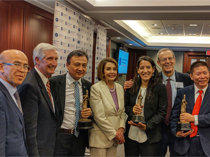 Dolkun Isa (third left) with Nancy Pelosi (center) (Photo courtesy of Yu Ping)
