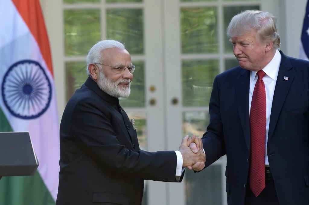 印度總理莫迪(左)與美國總統川普(圖 / 美聯社)