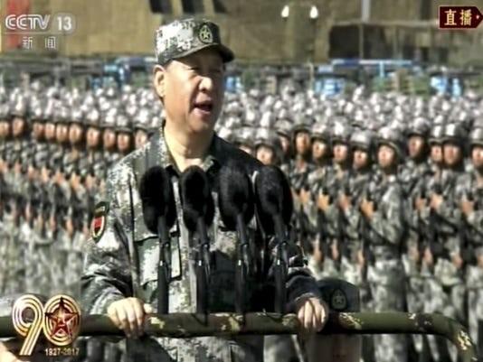Xi Jinping speaking before troops.