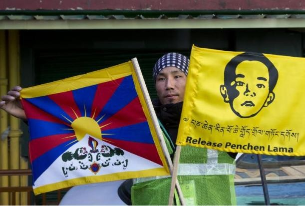 A Tibetan youth tries to draw attention to the fate of the original Panchen Lama