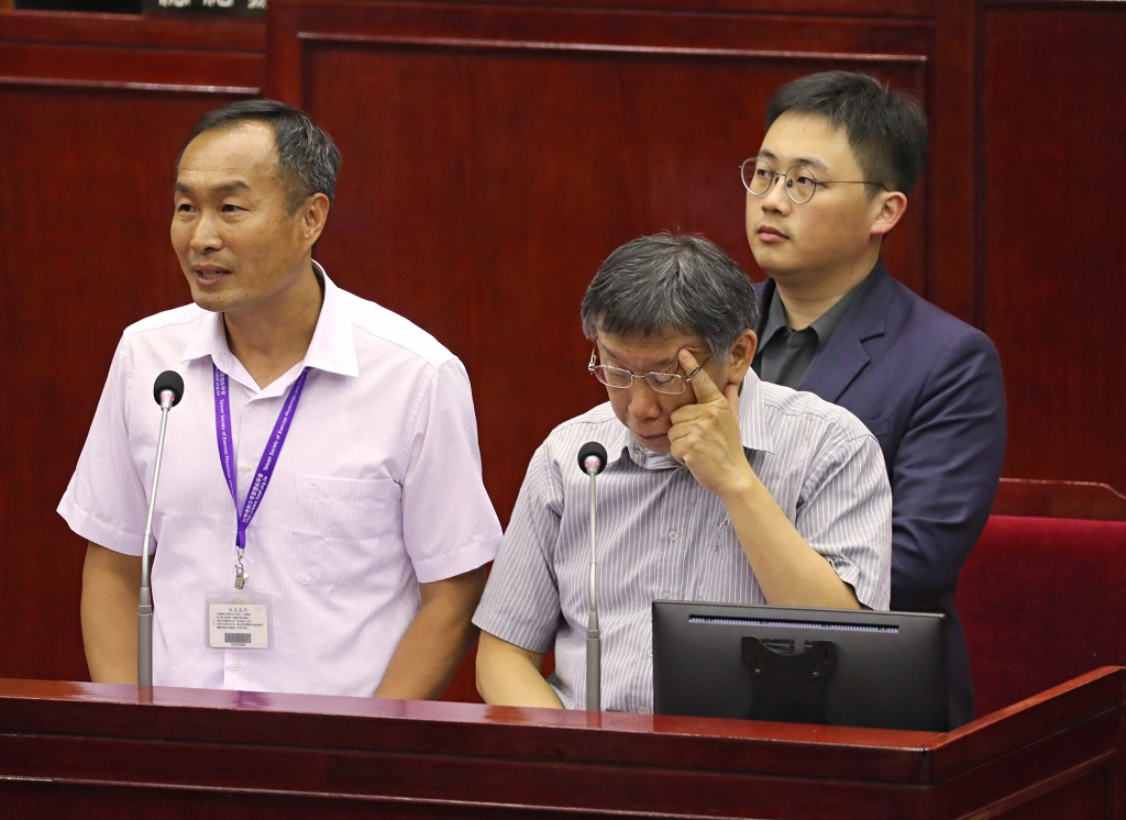 Taipei Mayor Ko Wen-je (front right) facing questions at the City Council Thursday June 13