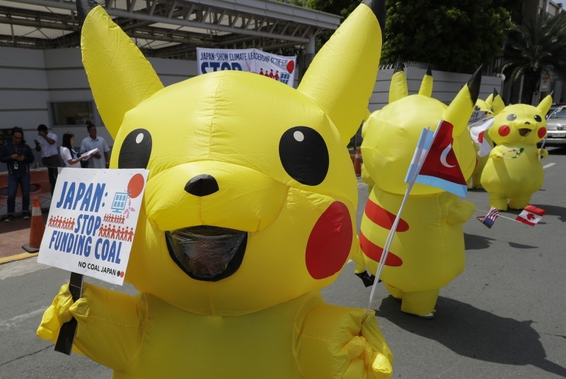 Environment activists dressed as Pikachu during demonstration