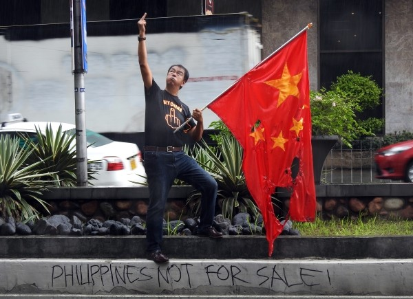 Carbonell giving finger to Chinese consulate.