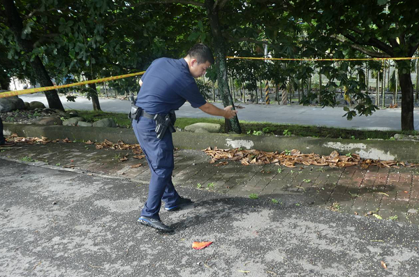 Police officer at the scene of the crime