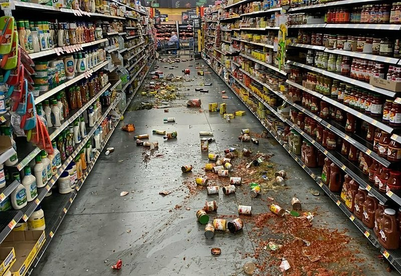 Food litters floor of an aisle at a Walmart after earthquake in Yucca Yalley, Calif., Friday, July 5