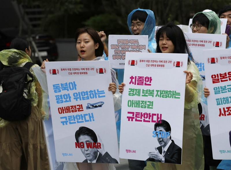 South Korean students denounce Japan government in Seoul.