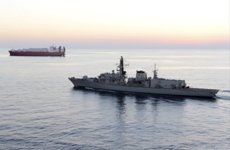 British navy vessel HMS Montrose escorts another ship during a mission to remove chemical weapons from Syria (AP photo)
