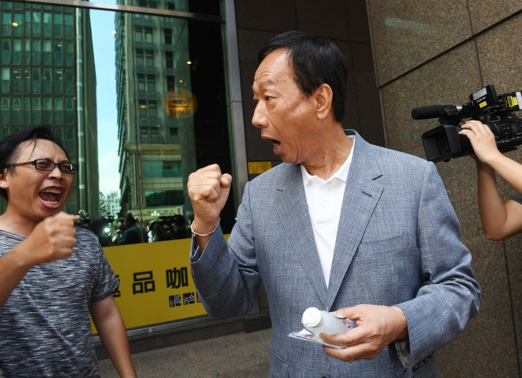 Presidential hopeful Terry Gou (right) meets supporters Friday July 12.