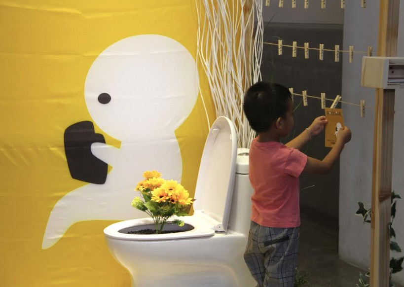 The art installation, Flowers in the Toilet, is a highlight of the exhibition. (NMTL photo)