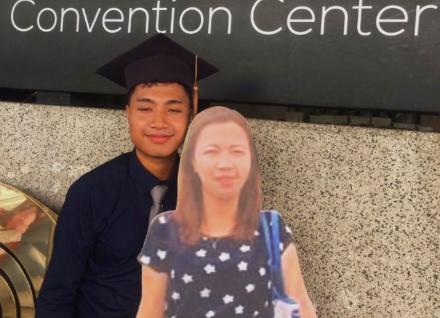 Filipino graduate with cardboard cut-out of mother. (Paulo John Alinsog photo)