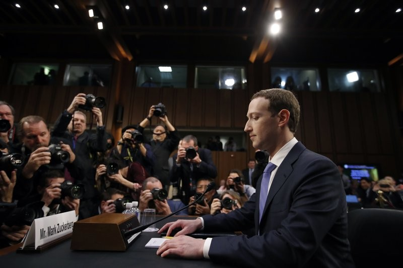 File photo: Facebook CEO Mark Zuckerberg takes before a joint hearing of the Commerce and Judiciary Committees, April 10, 2018