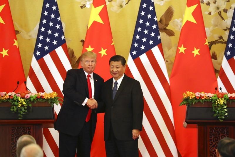 Donald Trump (left) and Xi Jinping (AP photo)