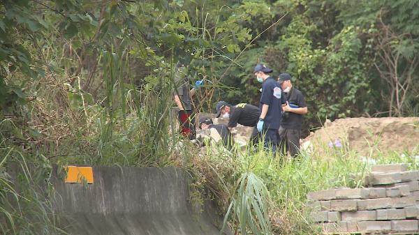 Investigators at the scene, July 28