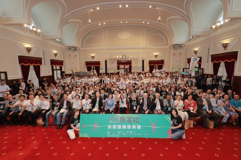 President Tsai Ing-wen (second row, 10th left) and Minister without Portfolio Audrey Tang (second row, ninth left) join other officials and this year'...