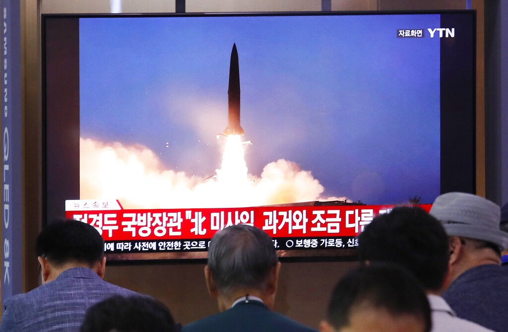 People watch a TV showing a file image of North Korea's missile launch during a news program at the Seoul Railway Station in Seoul, South Korea, Wedne...