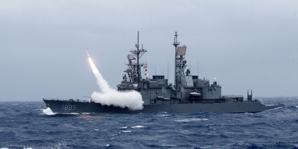 Kidd class destroyer launching missile.