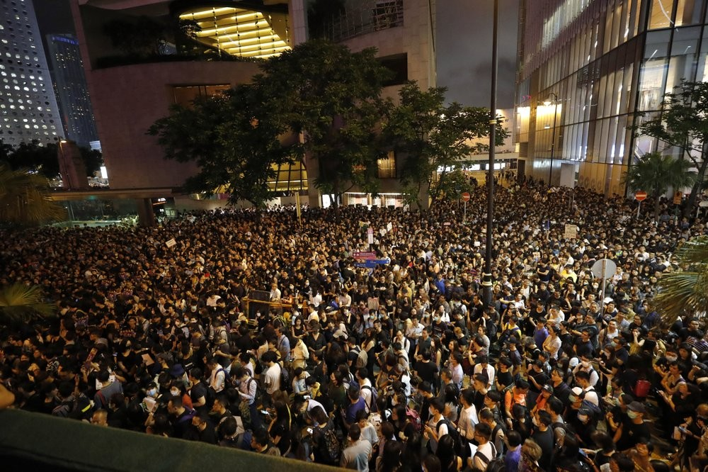 Hong Kong civil servants and supporters crowded into a public park Friday, Aug. 2