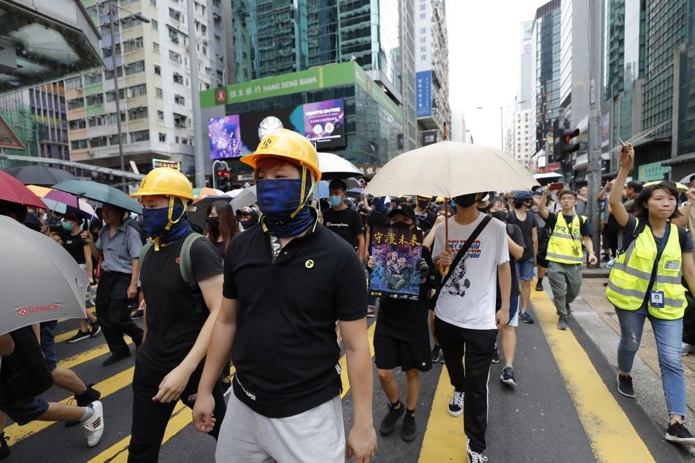 Protesters walking through Mong Kok neighborhood in Hong Kong Saturday August 3.