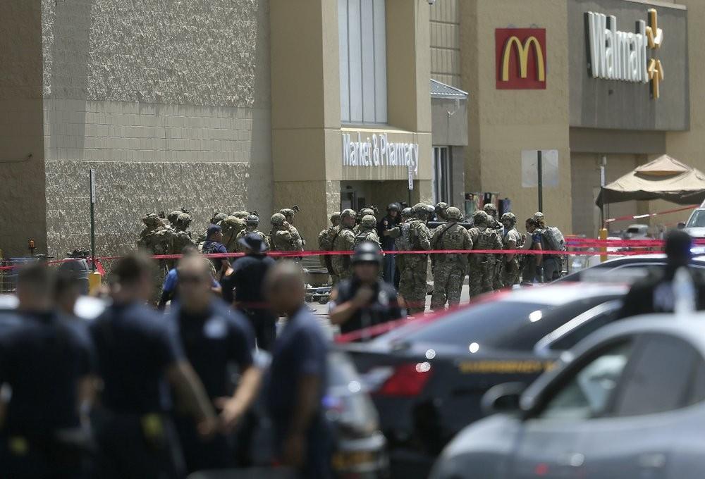 Law enforcement agencies respond to an active shooter Saturday, Aug. 3,at a Walmart in El Paso