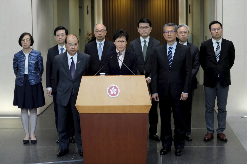 Carrie Lam and entourage address Hong Kong during city-wide strike, Aug. 5
