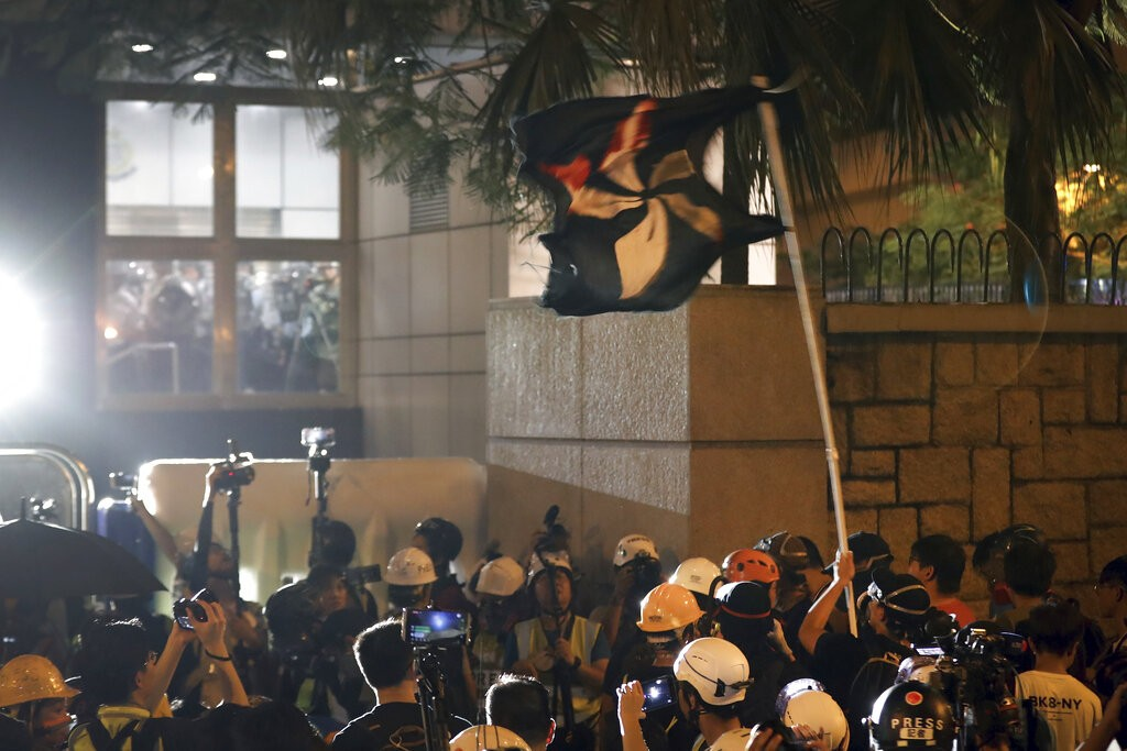 Hong Kong police tear skirt, underwear off female protester, sparking public wrath