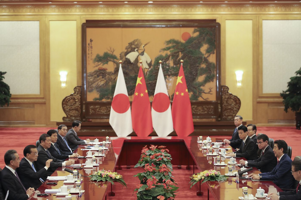 File photo: Japanese and Chinese officials speak during Japan PM Shinzo Abe's visit to Beijing, October 2018
