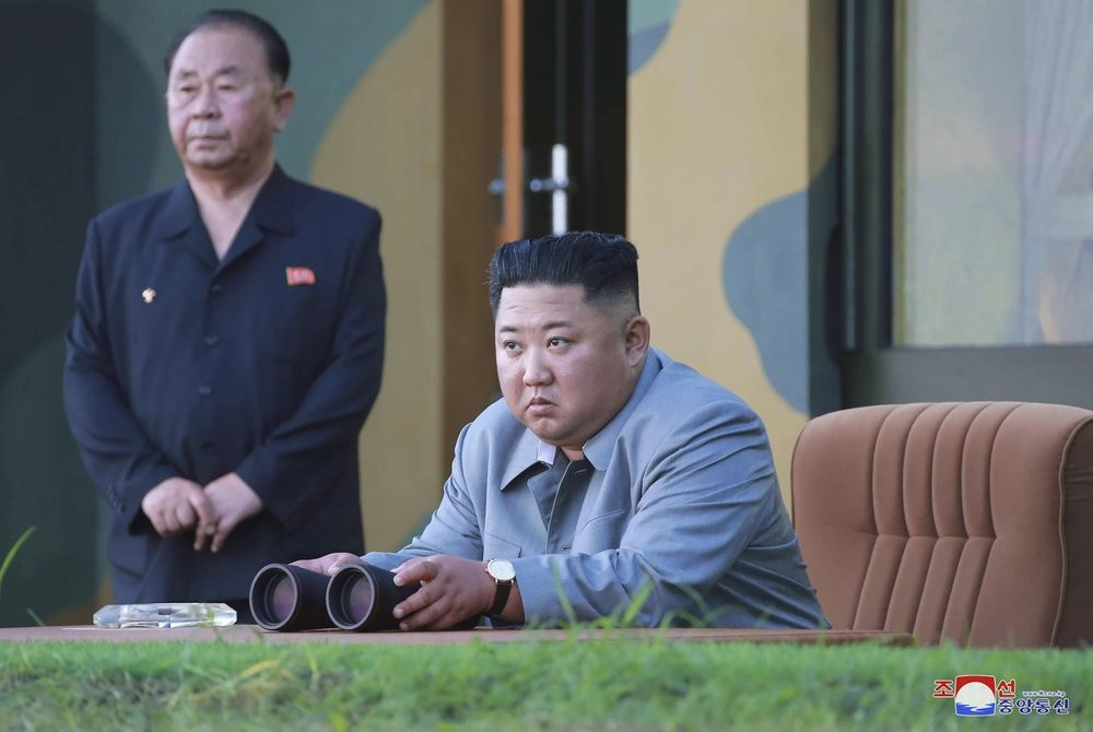 File photo: North Korean leader Kim Jong Un watches a missile test in North Korea on July 25