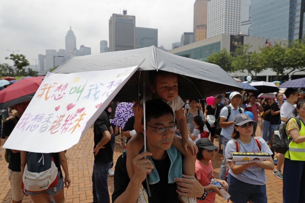 Parents with children protesting in Hong Kong Saturday August 10.