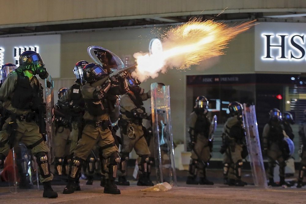 Riot police fire tear gas during anti-extradition bill protest in Hong Kong, Aug. 11