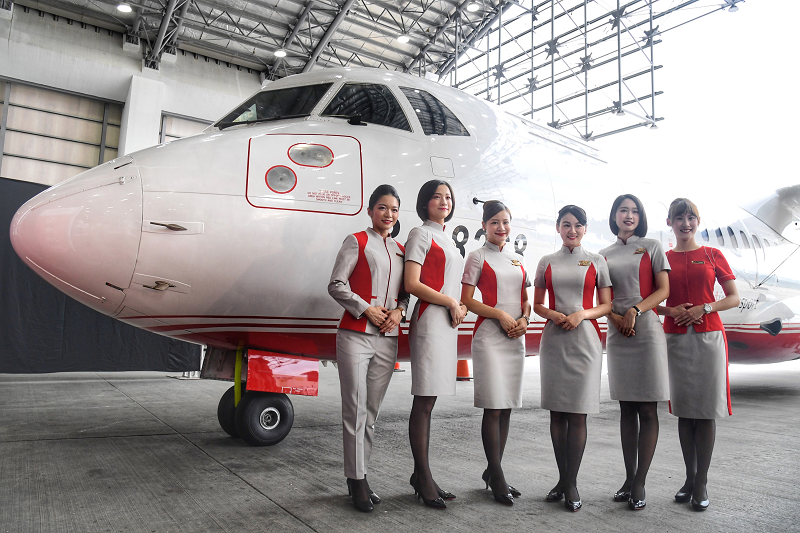 Models wearing new FAT crew uniforms in front of ATR72-600 aircraft, Aug. 12