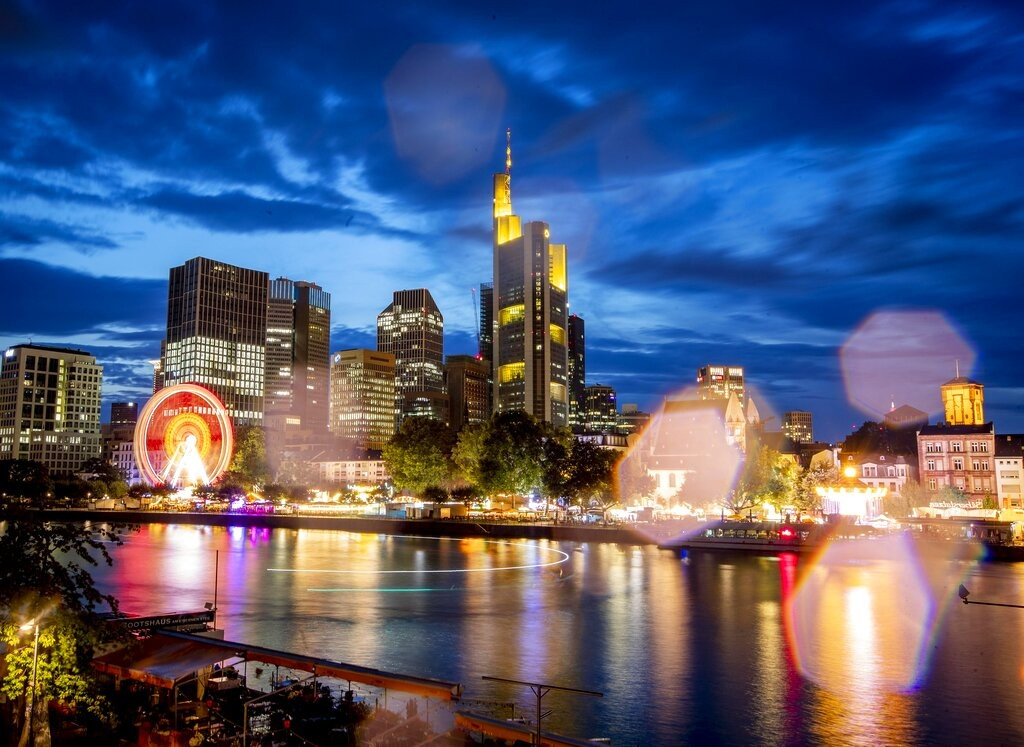 Raindrops on the camera lens reflect the lights of the Mainfest event at the river Main in Frankfurt, Germany, late Friday, Aug. 2, 2019.