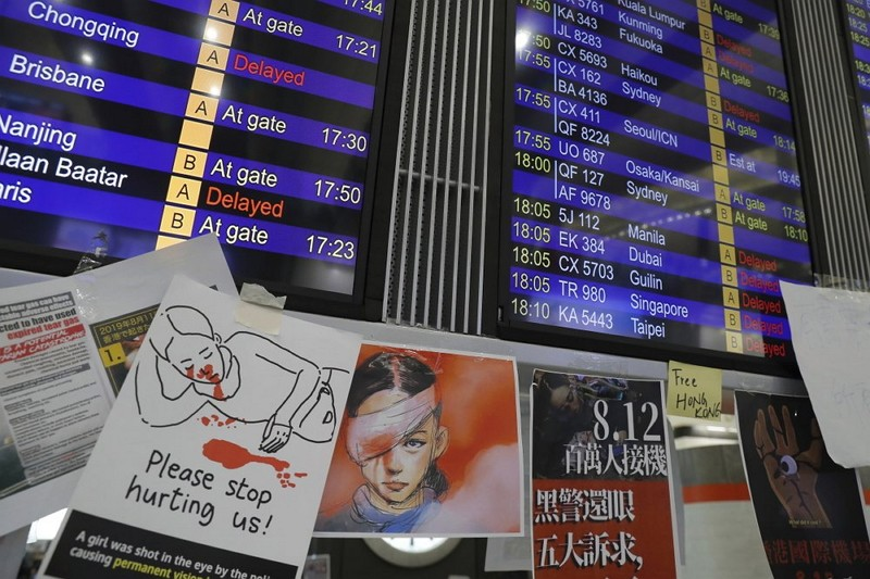 Protest placards are placed around the flights information board at the Hong Kong International Airport (AP)