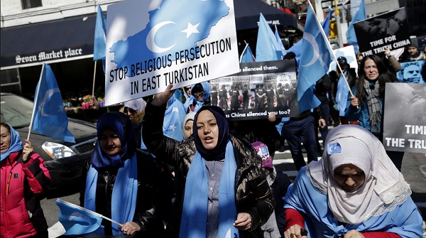 Uyghur women and supporters demonstrate against China before UN