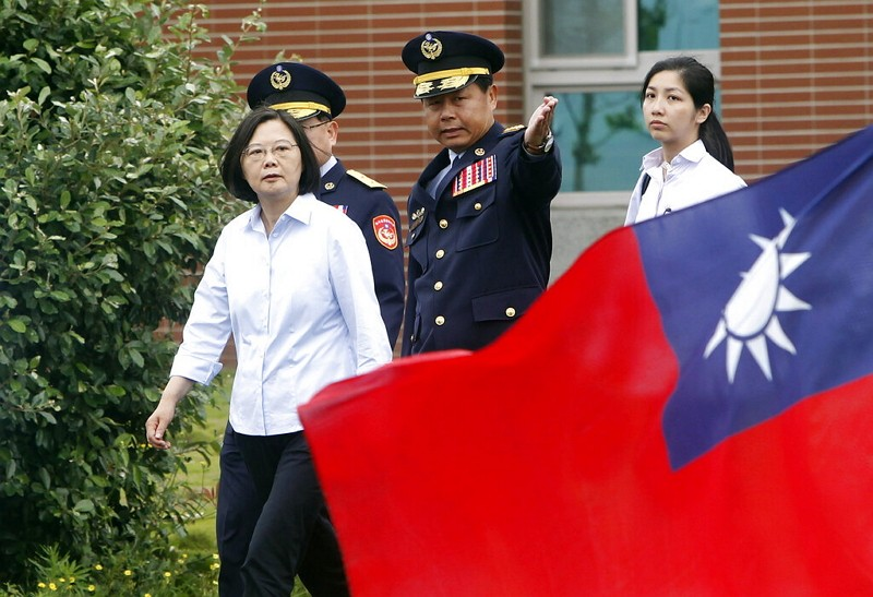 Taiwan's President Tsai Ing-wen, left, walks past a Taiwan national flag during an offshore anti-terrorism drill (AP photo)