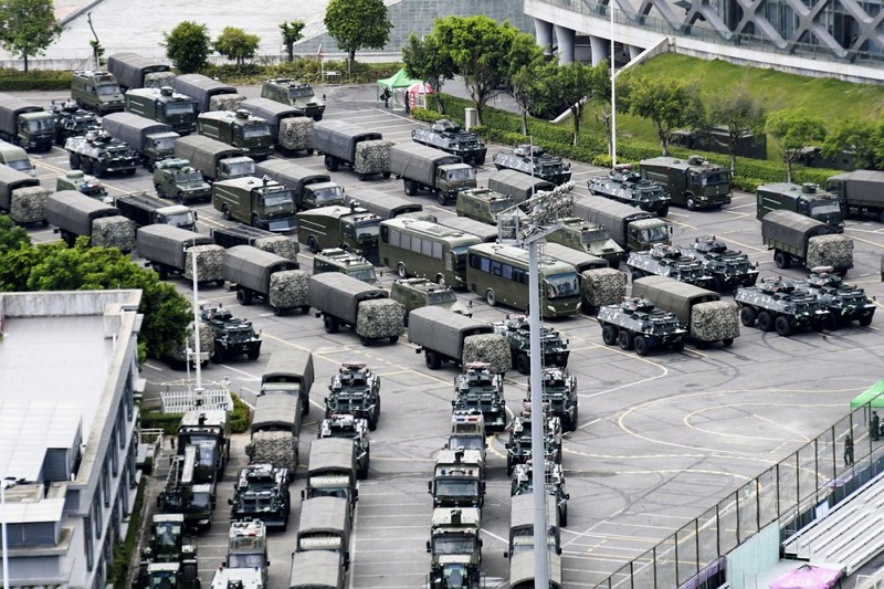 Photo shows armored vehicles and troop trucks are parked outside Shenzhen Bay Stadium in Shenzhen. (AP photo)
