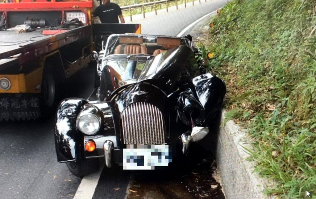 The Morgan Plus 4 after the accident on a Pinglin mountain road.