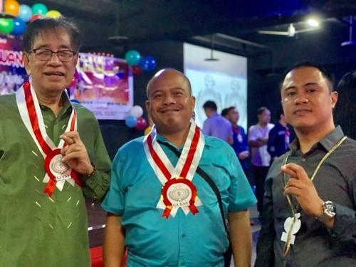 CIASI International Chairman Julius Magno (left), Nelson Palaris (center), assistant director for notarials at MECO, and CIASI Taiwan National Chairma...