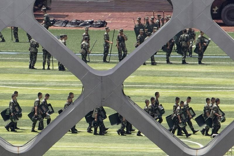 Chinese paramilitary policemen go through drills at the Shenzhen Bay Stadium in Shenzhen. (AP photo)