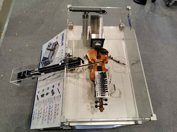 Machine designed by Taiwan CHELIC Corp. to play violin