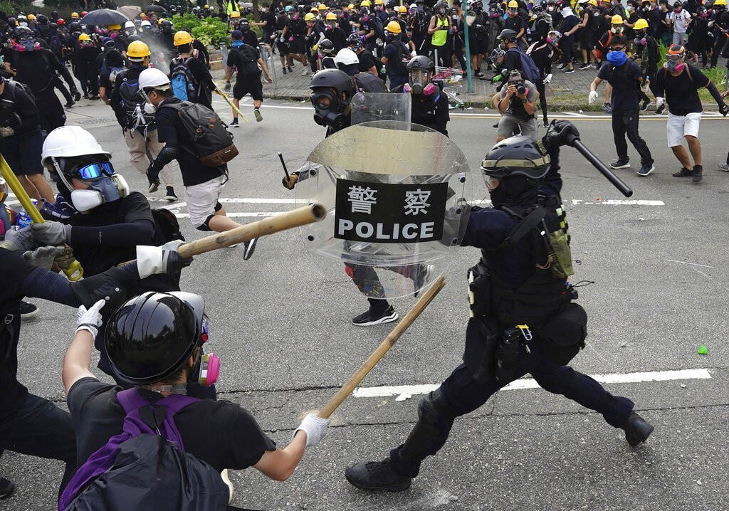 Police and demonstrators clash during a protest in Hong Kong on Aug. 24, after more than a week of peaceful demonstrations (Source: AP)